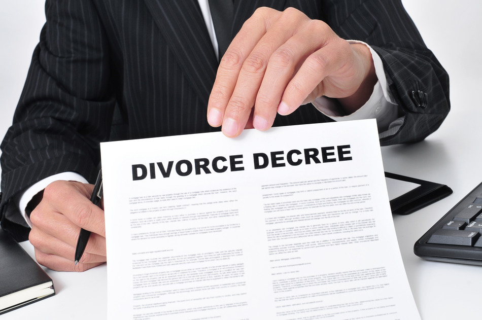 closeup of a lawyer sitting in his desk showing a divorce decree